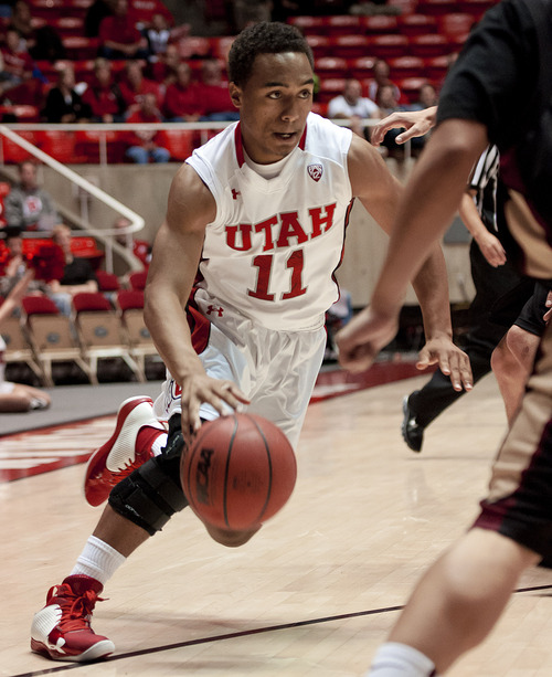 Michael Mangum  |  Special to the Tribune  Utah guard Brandon Taylor (11) drives into pressure during their game against the Willamette Bearcats at the Huntsman Center on Friday, November 9, 2012. The Utes beat the Bearcats 104-47.