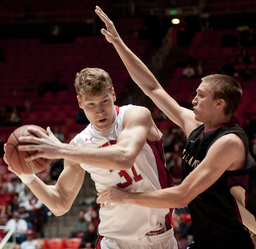 Michael Mangum  |  Special to the Tribune  Utah center Dallin Bachynski (31) battles pressure from Willamette Bearcats forward Kyle McNally (4) during their game at the Huntsman Center on Friday, November 9, 2012. Bachynski finished with 10 rebounds and 11 points as the Utes beat the Bearcats 104-47.