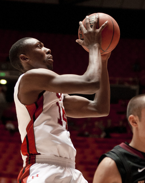 Michael Mangum  |  Special to the Tribune  Utah wingman Dakarai Tucker (14) flies for a layup during their game against the Willamette Bearcats at the Huntsman Center on Friday, November 9, 2012. Tucker finished with 15 points as the Utes beat the Bearcats 104-47.