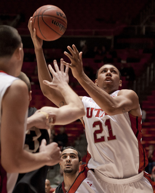 Michael Mangum  |  Special to the Tribune  Utah forward Jordan Loveridge (21) drives for a layup during their game against the Willamette Bearcats at the Huntsman Center on Friday, November 9, 2012. Loveridge led the team with 10 rebounds and 18 points as the Utes beat the Bearcats 104-47.