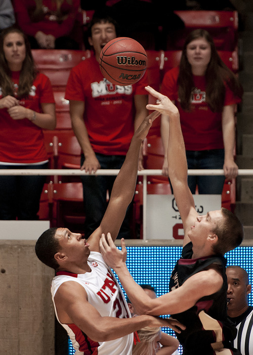Michael Mangum  |  Special to the Tribune  Utah forward Jordan Loveridge (21) blocks a shot from Willamette Bearcats forward Kyle McNally (4) during their game at the Huntsman Center on Friday, November 9, 2012. Loveridge led the team with 10 rebounds and 18 points as the Utes beat the Bearcats 104-47.