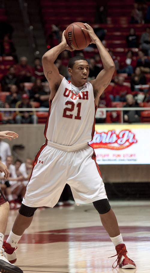 Michael Mangum  |  Special to the Tribune  Utah forward Jordan Loveridge (21) looks to make a pass during their game against the Willamette Bearcats at the Huntsman Center on Friday, November 9, 2012. Loveridge led the team with 10 rebounds and 18 points as the Utes beat the Bearcats 104-47.