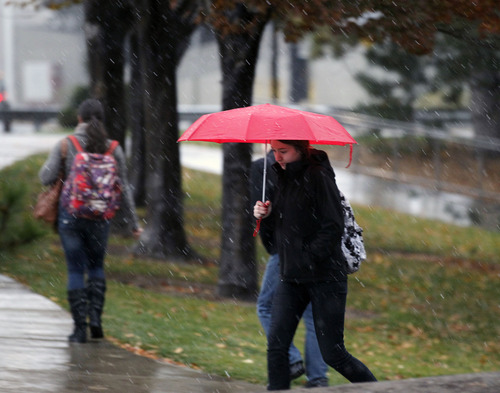 Al Hartmann  |  The Salt Lake Tribune Foul-weather gear and umbrellas come out Friday morning at the University of Utah as rain turns to sleet. Get used to it for the weekend.