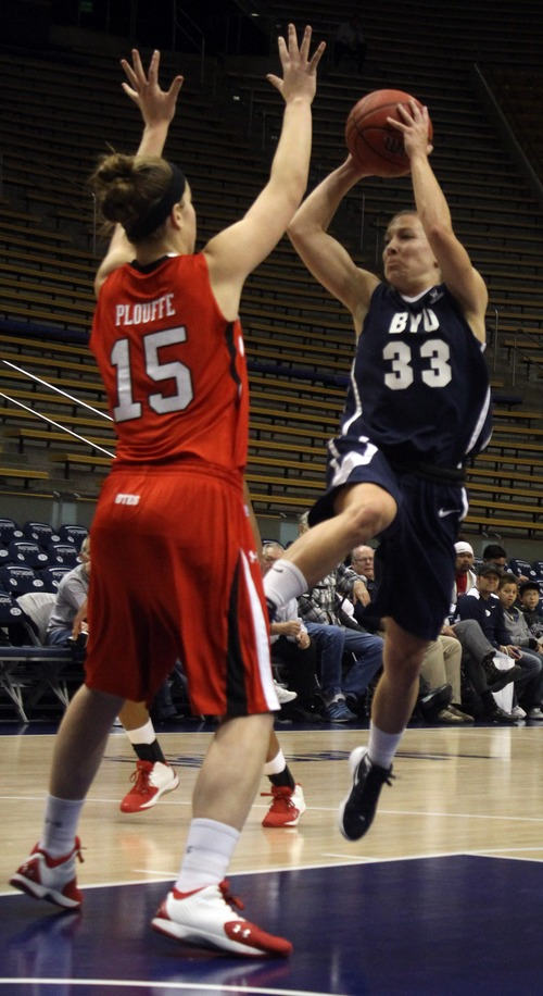 Rick Egan  | The Salt Lake Tribune   Michelle Plouffe (15) defends for the Ute's, as Haley Steed shoots for the Cougars,  in basketball action, BYU vs. Utah, at the Marriott Center in Provo,   Saturday, December 10, 2011.
