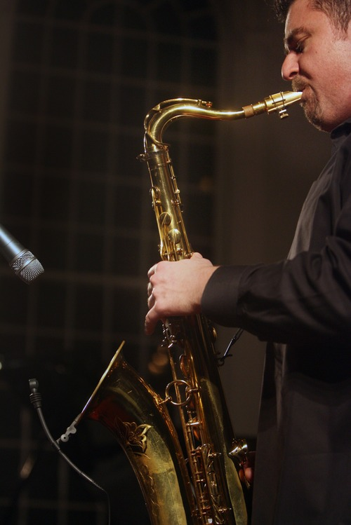 """Kim Raff I The Salt Lake Tribune The Jazz Vespers member, David Halliday, plays the saxophone during the performance """"A Tribute to the Beatles"""" at the First Unitarian Chruch in Salt Lake City , Utah on December 11, 2011."""