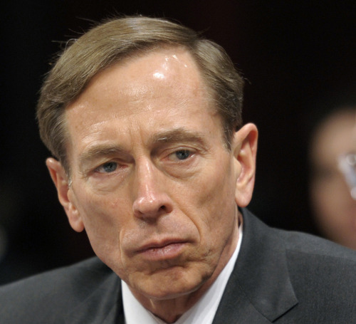 FILE - This Feb. 2, 2012 file photo shows CIA Director David Petraeus testifying on Capitol Hill in Washington. Petraeus has resigned because of an extramarital affair.  (AP Photo/Cliff Owen, File)