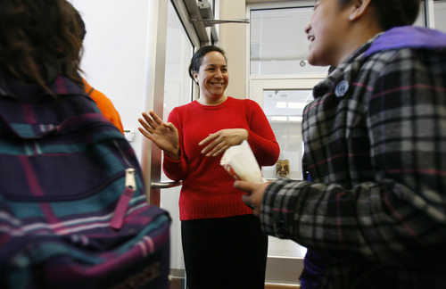 Francisco Kjolseth  |  The Salt Lake Tribune Ofa Moeai, executive director of the Pacific Heritage Academy charter school in North Salt Lake that opened its doors this year, says goodbye to the students for the weekend on Friday, November 9, 2012. Enrollment numbers are out, and the state's public school population has topped 600,000 for the first time, and the state's charter school population has topped 50,000 for the first time.