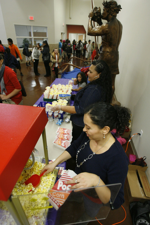 Francisco Kjolseth  |  The Salt Lake Tribune Parent group members Jessica Thompson, bottom, and Amelia Lafo sell popcorn on Friday, November 9, 2012, as part of ongoing fundraising efforts at the Pacific Heritage Academy charter school in North Salt Lake that opened its doors this year. Enrollment numbers are out, and the state's public school population has topped 600,000 for the first time, and the state's charter school population has topped 50,000 for the first time.