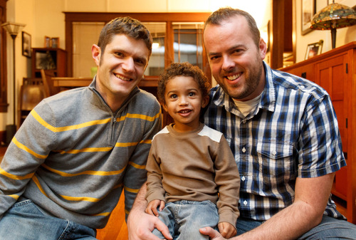 Trent Nelson  |  The Salt Lake Tribune Two-year-old Xander Clark with his two dads, Brandon Mark, left, and Weston Clark, at their home Friday November 9, 2012 in Salt Lake City.