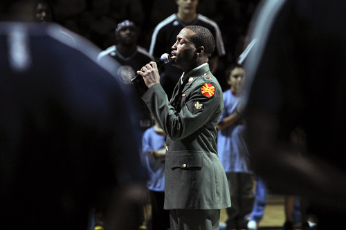 Xeaver Jones sings the national anthem before an NBA basketball game between the Utah Jazz and the Denver Nuggets, Friday, Nov. 9, 2012, in Denver. (AP Photo/Barry Gutierrez)