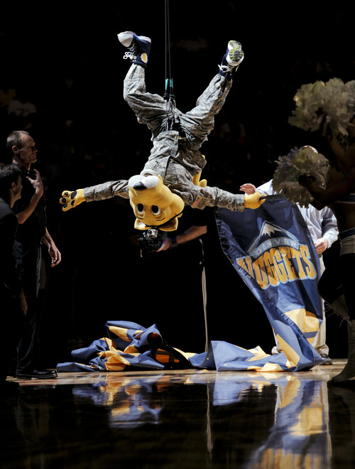 Rocky the Mountain Lion, the Denver Nuggets mascot, repels from the rafters of the Pepsi Center before the first quarter of an NBA basketball game against the Utah Jazz, Friday, Nov. 9, 2012 in Denver. (AP Photo/Barry Gutierrez)