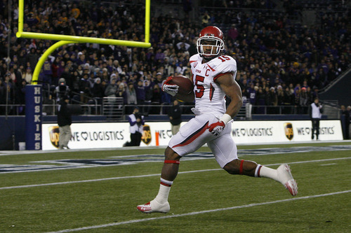 Scott Sommerdorf  |  The Salt Lake Tribune               Utah RB John White looks back to see he is all alone as he heads into the end zone with a 46 yard TD run to give the Utes an early lead. Utah led 8-7 Washington halfway through the second quarter at Century Link Field in Seattle, Saturday, November 10, 2012.