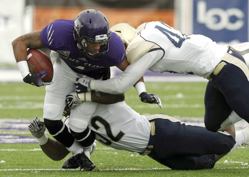 Weber State wide receiver Xavian Johnson breaks through a tackle during an NCAA college football game against Northern Colorado in Ogden, Utah, on Saturday, Nov. 10, 2012. (AP Photo/Standard-Exmainer, Kera Williams) MANDATORY CREDIT  TV OUT