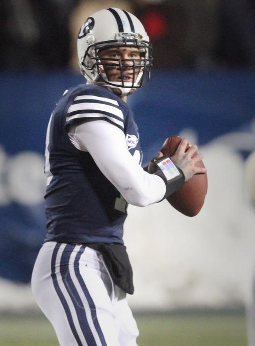Rick Egan  | The Salt Lake Tribune   Brigham Young Cougars quarterback Riley Nelson (13) throws the ball, in football action, BYU vs. Idaho Vandals, at Lavell Edwards Stadium, Saturday, November 10, 2012