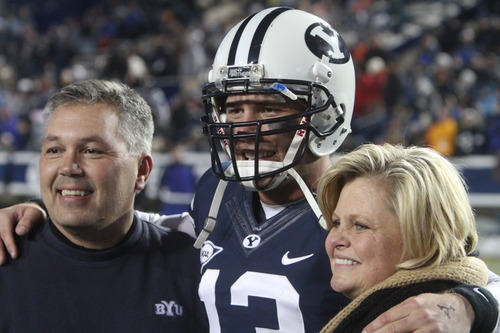 Rick Egan  | The Salt Lake Tribune   Brigham Young Cougars quarterback Riley Nelson (13) with his parents Keith (left) and Joni (right) before the BYU vs. Idaho Vandals, at Lavell Edwards Stadium, Saturday, November 10, 2012