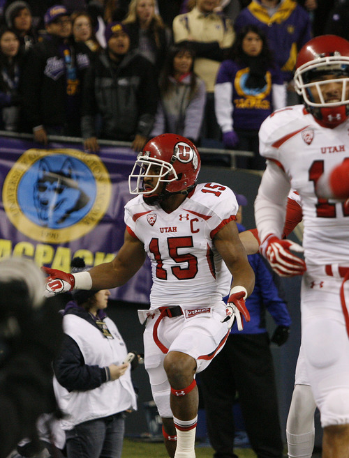 Scott Sommerdorf  |  The Salt Lake Tribune               Utah RB John White looks at the Huskie fans and celebrates his 46 yard TD run to give the Utes an early 8-0 lead. Utah trailed Washington 14-8 at the half at Century Link Field in Seattle, Saturday, November 10, 2012.
