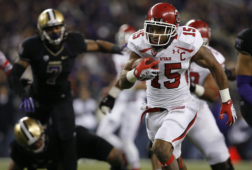 Scott Sommerdorf  |  The Salt Lake Tribune               Utah RB John White breaks through the line on his 46 yard TD run to give the Utes an early lead. Utah led 8-7 Washington halfway through the second quarter at Century Link Field in Seattle, Saturday, November 10, 2012.