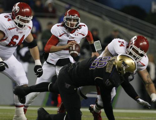 Scott Sommerdorf  |  The Salt Lake Tribune               Utah QB Travis Wilson scrambles to make a play late in the game at Century Link Field in Seattle, Saturday, November 10, 2012.