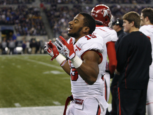 Scott Sommerdorf  |  The Salt Lake Tribune               Utah RB John White reacts to the taunting by Huskie fans after he came to the bench following his 46 yard TD run to give the Utes an early 8-0 lead. Utah trailed Washington 14-8 at the half at Century Link Field in Seattle, Saturday, November 10, 2012.