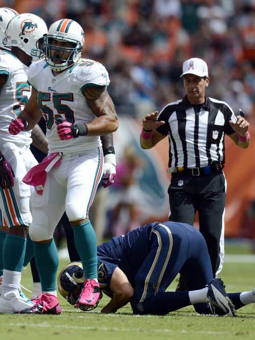 Miami Dolphins outside linebacker Koa Misi (55) celebrates after St. Louis Rams quarterback Sam Bradford  (8) was sacked during the first half of an NFL football game Sunday, Oct. 14, 2012 in Miami . AP Photo/Rhona Wise)