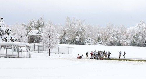 Leah Hogsten  |  The Salt Lake Tribune The junior high school Kaysville Attack football team practices Saturday, November 10, 2012 at Nicholls Park on a strip of green grass that was snowplowed clean so that the boys could get in some plays before their big football tournament in Mesquite next weekend. Scattered snowfall is expected to continue throughout Saturday, with increasing lake-effect accumulations stretching into the evening in areas south and east of the Great Salt Lake, piling on four to five more inches by Sunday morning.