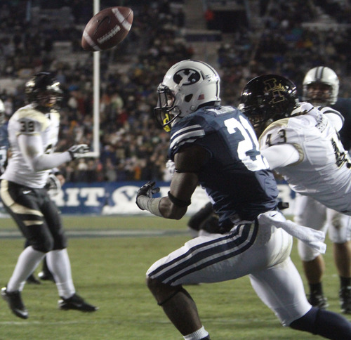 Rick Egan  | The Salt Lake Tribune   Brigham Young Cougars running back Jamaal Williams (21)is hit by Idaho Vandals defensive end Quinton Bradley (43) sling control of the ball, in football action, at Lavell Edwards Stadium, Saturday, November 10, 2012