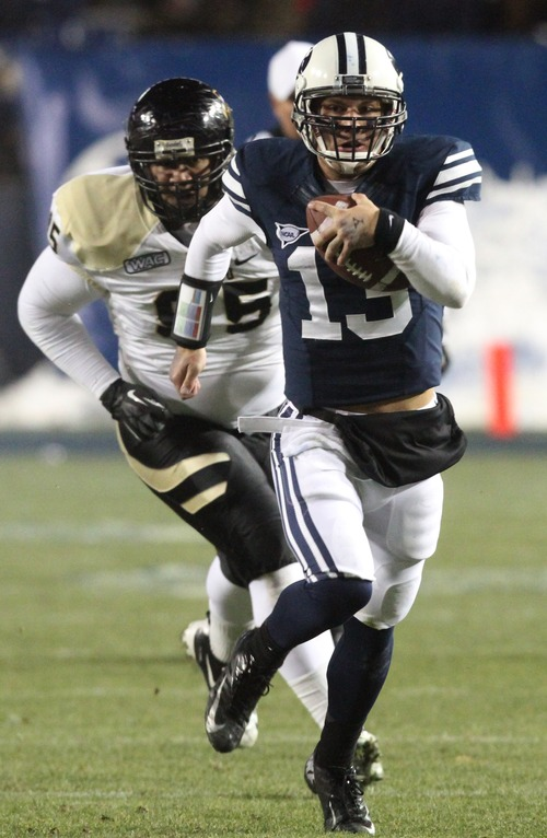 Rick Egan  | The Salt Lake Tribune   Brigham Young Cougars quarterback Riley Nelson (13) is chased by Idaho Vandals defensive tackle Ryan Edwards (95) as he runs for a first down on a quarterback keeper, in football action, BYU vs. Idaho Vandals, at Lavell Edwards Stadium, Saturday, November 10, 2012