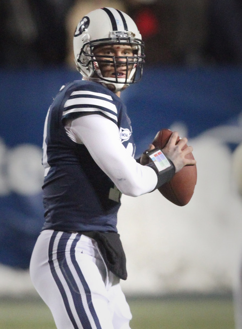 Rick Egan  | The Salt Lake Tribune   Brigham Young Cougars quarterback Riley Nelson (13) throws the ball, in football action, BYU vs. Idaho Vandals, at Lavell Edwards Stadium, Saturday, November 10, 2012