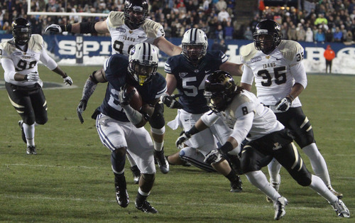 Rick Egan  | The Salt Lake Tribune   Brigham Young Cougars running back Jamaal Williams (21) runs for a touchdown, in football action, BYU vs. Idaho Vandals, at Lavell Edwards Stadium, Saturday, November 10, 2012