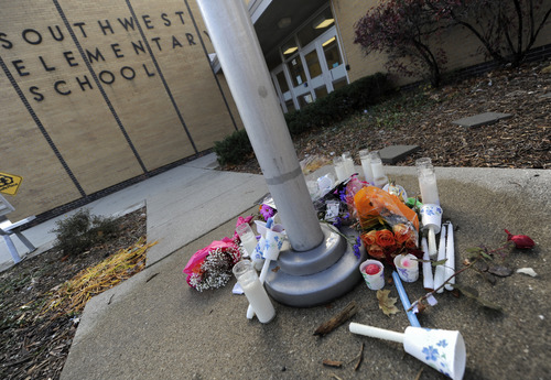 A memorial is set up outside Southwest Elementary school in Greenwood, Ind., Monday Nov. 12, 2012 for victims of the explsion in Indianapolis.   The coroner's office had not yet identified the two people killed in the blast, but a candlelight vigil was held Sunday at the school where Jennifer Longworth teaches.  (AP Photo/The Daily Journal,Scott Roberson)