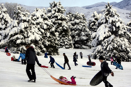 Kim Raff  |  The Salt Lake Tribune Crowds of people gather at Sugar House Park to sled after a snowstorm in Salt Lake City on Nov. 11, 2012.