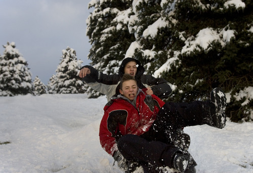 Kim Raff  |  The Salt Lake Tribune Mayson, back, and Tanner Skadburg go off of a jump while sledding at Sugar House Park in Salt Lake City on Nov. 11, 2012.