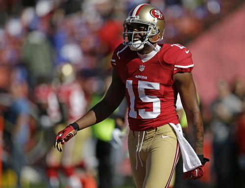 San Francisco 49ers wide receiver Michael Crabtree smiles during warmups before the start of an NFL football game against the St. Louis Rams in San Francisco, Sunday, Nov. 11, 2012. (AP Photo/Marcio Jose Sanchez)
