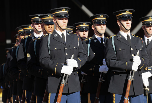 The U.S. Army Drill Team lines up during the second quarter of an NFL football game between the San Francisco 49ers and the St. Louis Rams in San Francisco, Sunday, Nov. 11, 2012. The team performed at halftime in a Salute to Service. (AP Photo/Jeff Chiu)