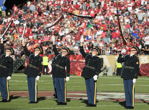 The U.S Army Drill Team performs at halftime during a Salute to Service in an NFL football game between the San Francisco 49ers and the St. Louis Rams in San Francisco, Sunday, Nov. 11, 2012. (AP Photo/Jeff Chiu)