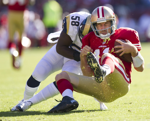San Francisco 49ers quarterback Alex Smith (11) is tackled by St. Louis Rams linebacker Jo-Lonn Dunbar (58) on a four-yard gain during the first quarter of an NFL football game, Sunday, Nov. 11, 2012, in San Francisco. Smith had a concussion from the play. (AP Photo/The Sacramento Bee, Paul Kitagaki Jr.)