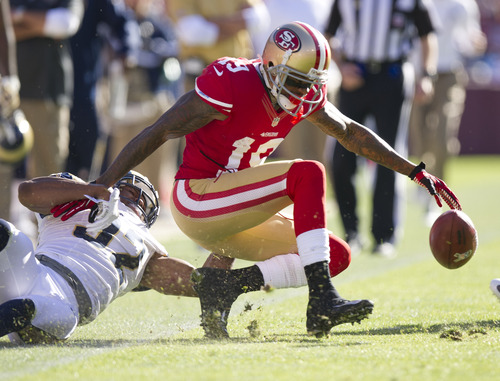 San Francisco 49ers wide receiver Ted Ginn (19) fumbles the kick off return after he was tackled by St. Louis Rams cornerback Bradley Fletcher (32) and the ball is recovered by the 49ers during the first quarter of an NFL football game, Sunday, Nov. 11, 2012, in San Francisco. (AP Photo/The Sacramento Bee, Paul Kitagaki Jr.) MAGS OUT; LOCAL TV OUT (KCRA3, KXTV10, KOVR13, KUVS19, KMAZ31, KTXL40); MANDATORY CREDIT.