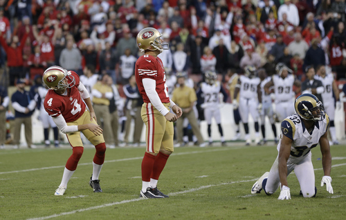 San Francisco 49ers kicker David Akers (2) watches with Andy Lee (4) as he misses a 33-yard field goal during overtime of an NFL football game against the St. Louis Rams in San Francisco, Sunday, Nov. 11, 2012. Also pictured is St. Louis Rams cornerback Bradley Fletcher (32). San Francisco and St. Louis tied their game 24-24. (AP Photo/Marcio Jose Sanchez)