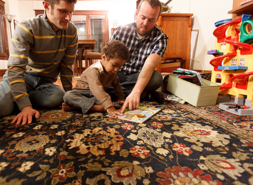 Trent Nelson  |  The Salt Lake Tribune Brandon Mark, left, and Weston Clark play with their 2-year-old son, Xander Clark, in their home Friday, November 9, 2012 in Salt Lake City.