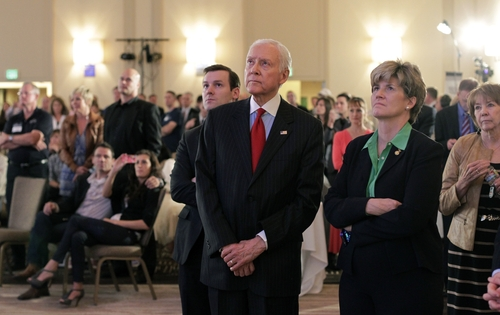 Sen. Orrin Hatch, R-Utah, watches the TV screen as Republican presidential candidate and former Massachusetts Gov. Mitt Romney gives his concession speech during a Utah Republican Party Election Night watch party Tuesday, Nov. 6, 2012, in Salt Lake City.  (AP Photo/Rick Bowmer)