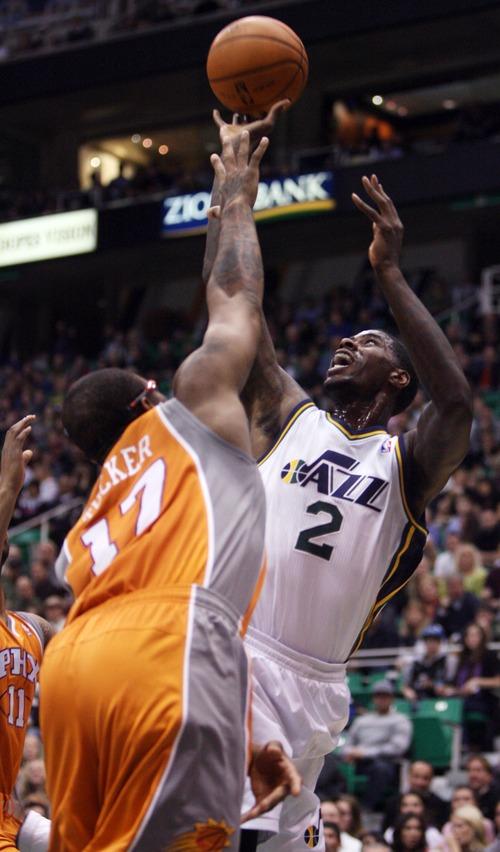 Kim Raff  |  The Salt Lake Tribune (left) Phoenix Suns shooting guard P.J. Tucker (17) defends as Utah Jazz power forward Marvin Williams (2) takes a shot during a game at EnergySolutions Arena in Salt Lake City, Utah on November 10, 2012.