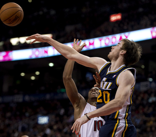 Toronto Raptors guard DeMar DeRozan shot attempt is rejected by Utah Jazz guard Gordon Hayward (20) during the first half of an NBA basketball game, Monday, Nov. 12, 2012, in Toronto. (AP Photo/The Canadian Press, Frank Gunn)