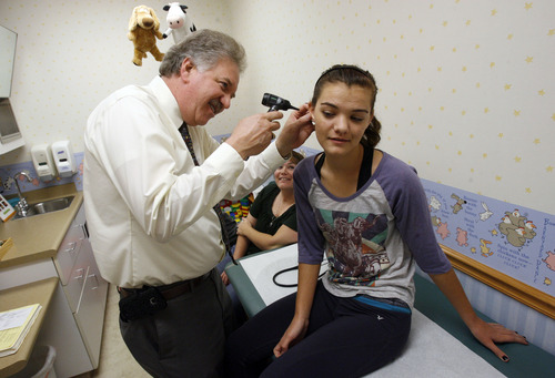Francisco Kjolseth     The Salt Lake Tribune Keith Ramsey, an osteopathic pediatrician in South Jordan, checks Kaylee Franklin, 16, of West Valley as her sister Jacquie Robb, left, and her mom Michelle Robb sit in on Monday, Nov. 5, 2012. Osteopathic schools of medicine are eyeing Utah as ripe for competing alternatives to the U.'s medical school. But are osteopathic doctors the same as traditional MD's? Yes, says Keith Ramsey, an osteopathic pediatrician in South Jordan. Osteopaths have the same level of training and can write prescriptions and do surgery. The only difference is they're also trained in a form of manipulation similar to what chiropractors use. But Ramsey, who works with children, rarely uses manipulation.