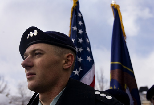 """Kim Raff     The Salt Lake Tribune Spencer Nelson, a cadet captain of the Taylorsville Army JROTC Color Guard, prepares to present the colors during a ceremony after Taylorsville's Veterans Day Parade. The theme for the parade is """"Welcome Home, Korean and Vietnam Veterans."""""""