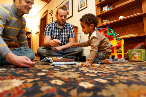 Trent Nelson     The Salt Lake Tribune Brandon Mark, left, and Weston Clark play with their 2-year-old son, Xander Clark, in their home Friday, November 9, 2012 in Salt Lake City.