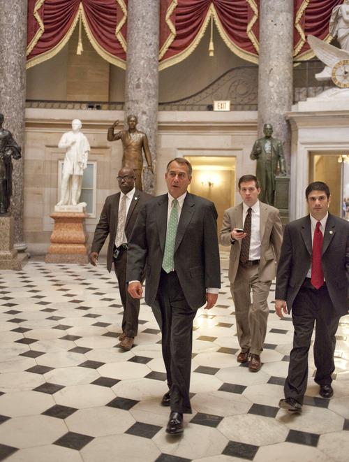 House Speaker John Boehner of Ohio walks to the House floor on Capitol Hill in Washington, Tuesday, Nov. 13, 2012, as the lame duck 112th Congress began. (AP Photo/Harry Hamburg)