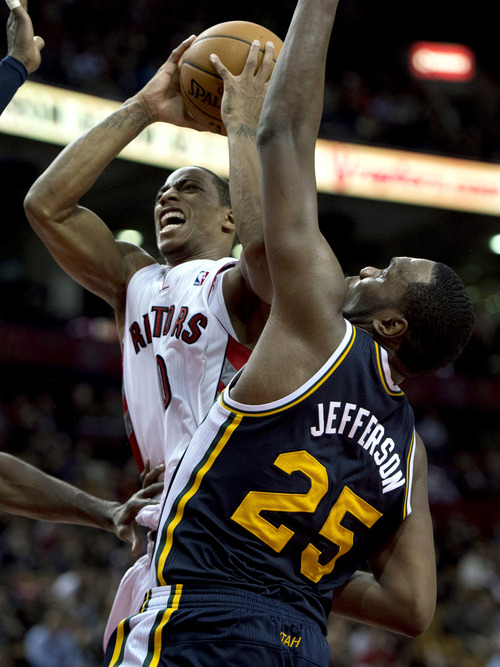 Toronto Raptors guard DeMar DeRozan drives to the hoop past Utah Jazz center Al Jefferson (25) during an NBA basketball game in Toronto on Monday, Nov. 12, 2012. (AP Photo/The Canadian Press, Frank Gunn)