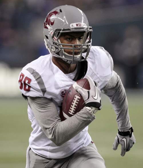"FILE - This Nov. 26, 2011 file photo shows Washington State's Marquess Wilson returning a reception for a 38-yard touchdown during the second half of an NCAA college football game against Washington, in Seattle. The star receiver's allegations that he has been physically and emotionally abused by coaches have roiled Washington State, and the school president has called for an investigation of Marquess Wilson's complaints against new coach Mike Leach and his staff. Wilson on Saturday, Nov. 10, 2012,  quit the team, saying coaches ""preferred to belittle, intimidate and humiliate us."" (AP Photo/Elaine Thompson, File)"