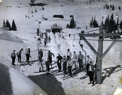 Tribune file photo  George Watson, Alta's first mayor, is seen at the far right with a group of spring skiers alongside Alta's first chairlift in this photo from 1940.
