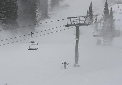 Scott Sommerdorf  |  The Salt Lake Tribune               A skier hikes up near the closed Collins Lift at Wildcat Base at Alta Ski Area, Friday, November 8, 2012
